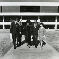 Leontyne Price walking with Chuck Holmes and other Founders Day guests.